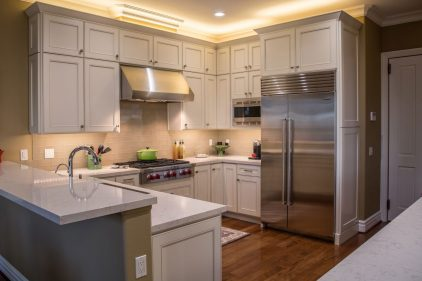 Remodeled Kitchen with wood flooring and Marble countertops