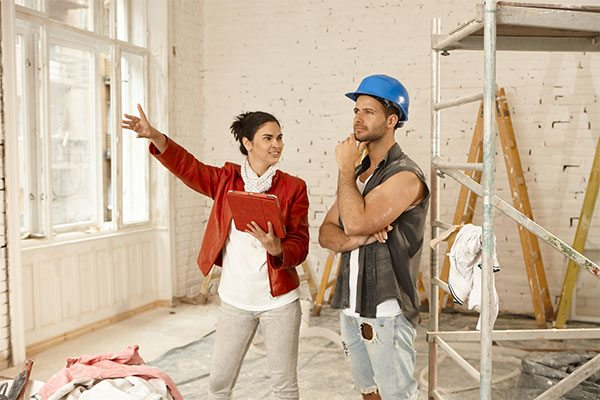 Homeowner asking her contractor a question